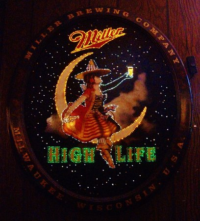 miller high life sign that changes picture of glass house tavern
