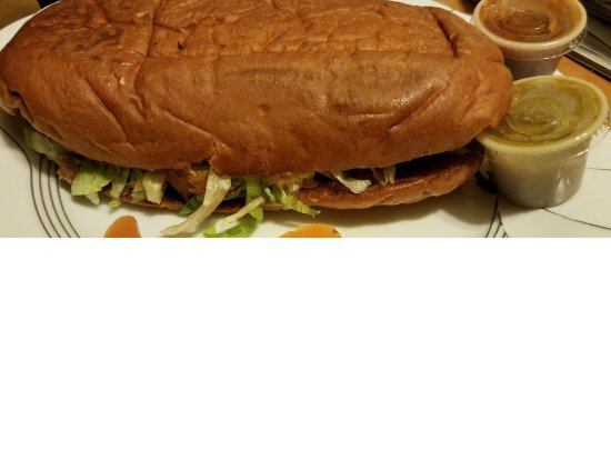 Taqueria Sanchez: Chicken Torta with lime, hot sauces and sliced pickled carrots