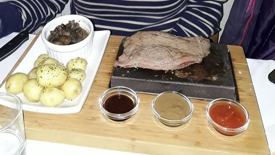 Monoloco: Part cooked steak on a hot stone so you can finish it off just how you like it.