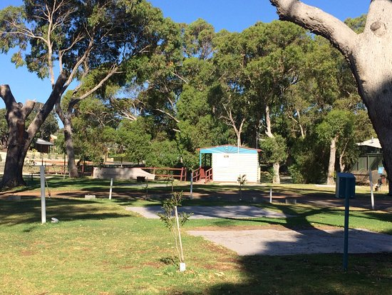 Binningup, Australia: Two bus parking bays, camp kitchen in background and tent area