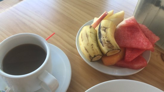 Beach Break Resort: Some fruit and coffee on buffet. Great! Eggs, meats, potatoes, rice, pastries too!