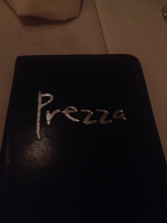 Prezza: Paying the bill after a great meal.