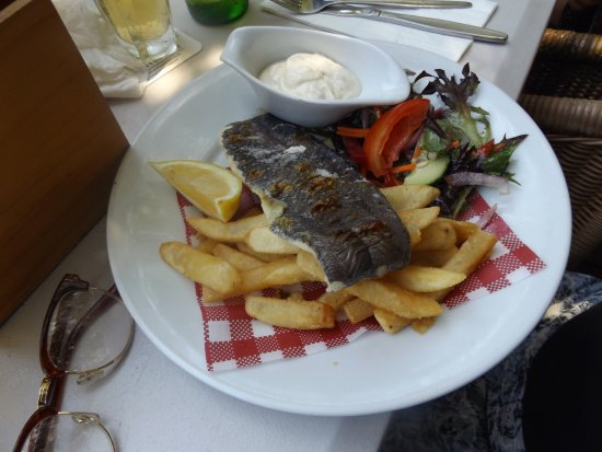 Bargara, Australia: Grilled fish and chips with inedible paper