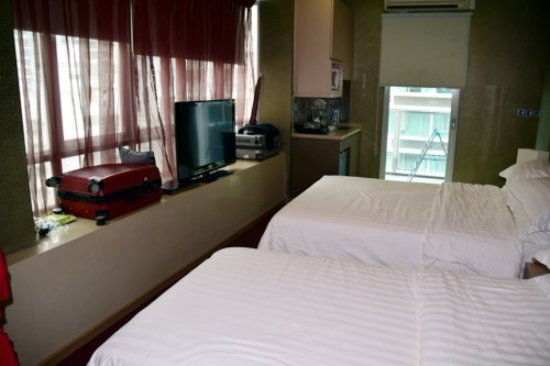 Hotel Royal Singapore: since we are three in a room, we have one double bed and one single bed ...