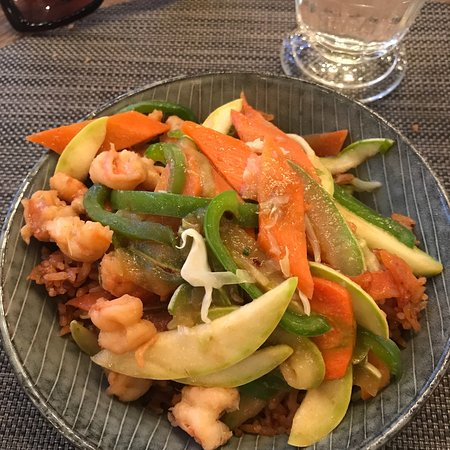 Stir fried shrimps with Jollof rice