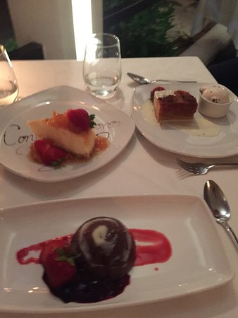 Lone Star Restaurant & Hotel: Our desserts plus our celebratory cheesecake! All delicious!