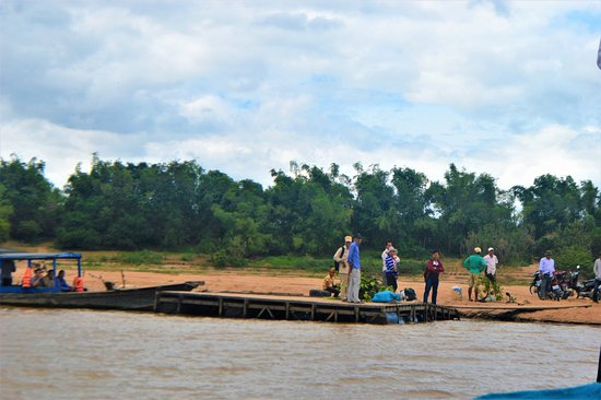 Cambodian Rural Discovery Tours: Waiting for the boat on the shore of the Mekong river