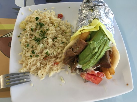 Yucaipa, CA: California gyro with rice pilaf, delicious! Packed with lamb, and look at that avocado! Deliciou