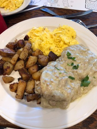 Middletown, CT: Biscuits covered in sausage gravy with home fries and scrambled eggs