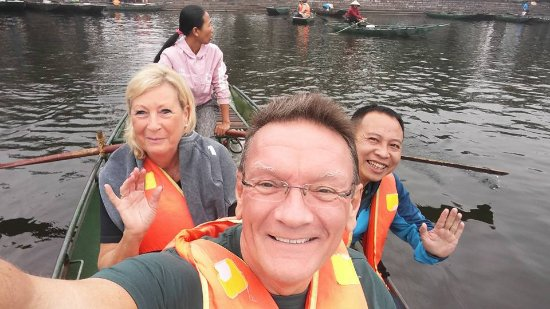 Tam Coc : My wife, guide and I with the lady rower (they row with their feet!)