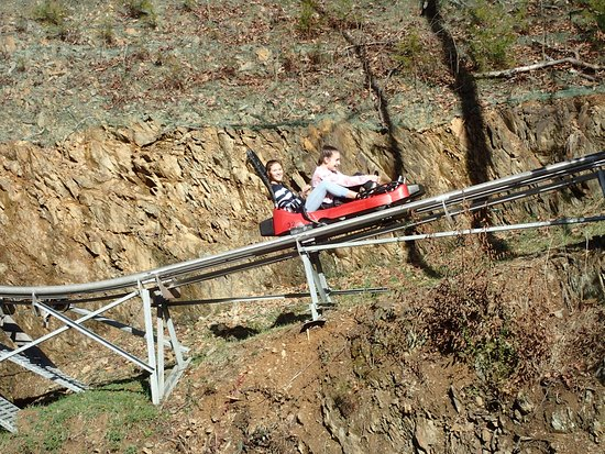 Smoky Mountain Alpine Coaster: On the incline to the peak. Can ride solo if over 16 or double if one is over 16.