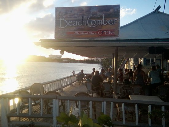 Island Beachcomber Hotel: Sunset at the Island Beach Comber Bar: Food and Refreshment to Help You Enjoy the Beach