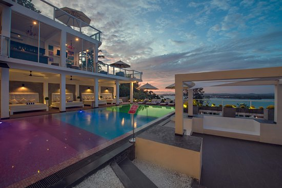 Take a swim in the tri-color pool at Cantaloupe Levels overlooking Jungle Beach.