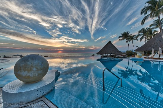 Grand Velas Riviera Nayarit: Pool area looking towards beach at sunset.
