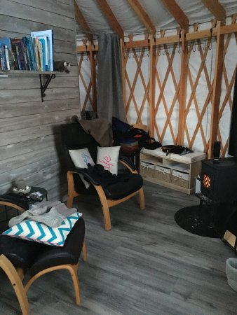 seating area in the yurt with wood stove for heat picture of
