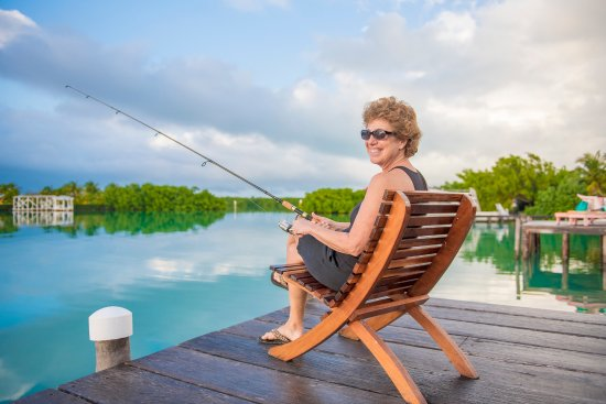 St. George's Caye Resort: Fishing off the dock of the Overwater Cabanas