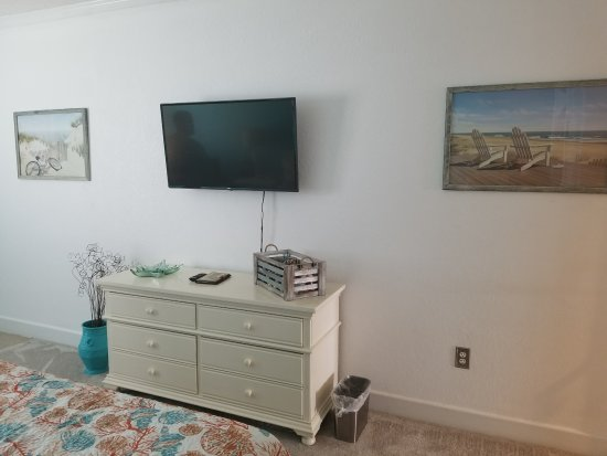 "The Villas of Hatteras Landing: Bedroom w/43"" wall- mounted TV"