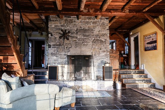 Addison, VT: Great Room (Main House) Stone fireplace with 18th century ceiling beams