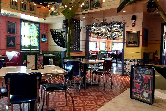 Chuy's Norman: We love Chuy's eclectic decor. This view is from the main dining room into a separate wing.