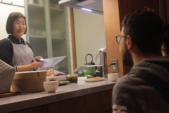 Suginami, Japan: Chatting host and guest across a kitchen countertop