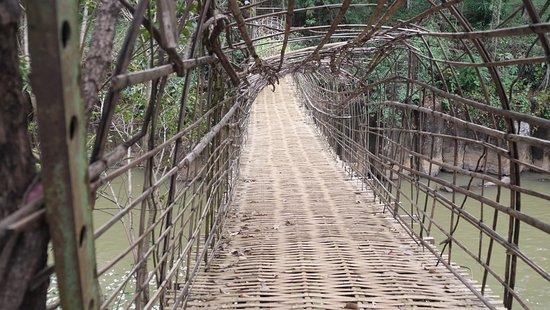 Tad Pha Suam Waterfall: bamboo bridge leading to the waterfall