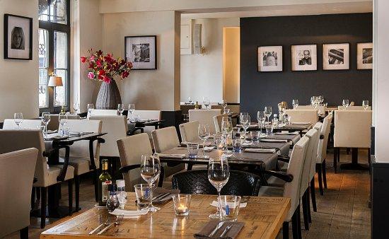 Lanaken, Belgio: Geniet van culinaire gerechten in een ontspannen ambiance.