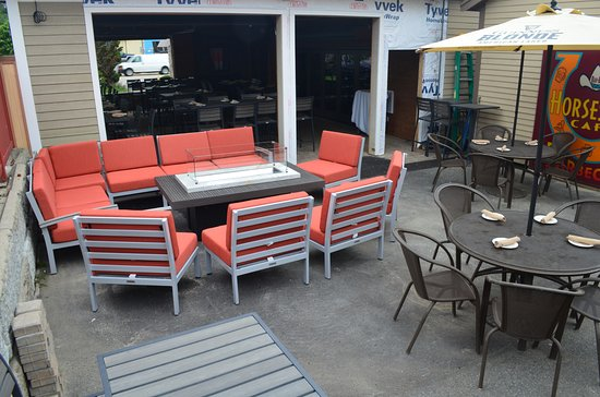 North Reading, MA: Outdoor patio with couch/chairs around fire pit.  Umbrella tables