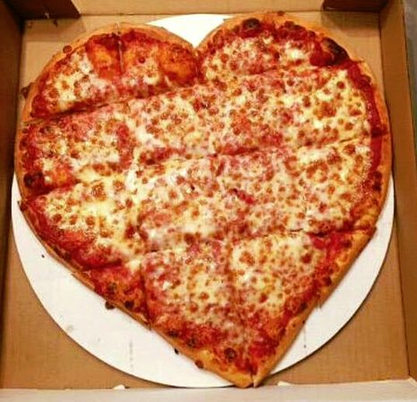 "Middleburg Heights, OH: It doesnt always have to be roses...Ask about our ""Heart' shaped pizza served all year!"