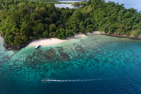 Bangka Island, Indonezja: Birds eye view of our resort with private secluded beach and house reef