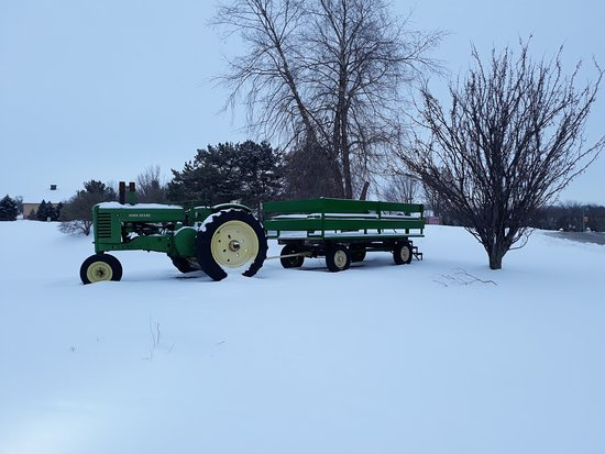 Urbandale, IA: Deere Tractor exhibit outside restaurant