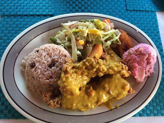 Kurt's Corner: Coconut Grouper w/ rice, veggies, plantains and potato salad.