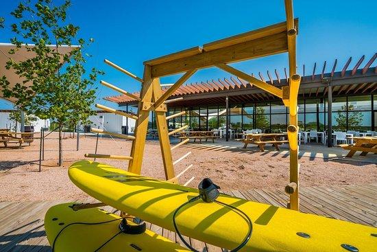 Del Valle, TX: Surfboard racks on the patio overlook.