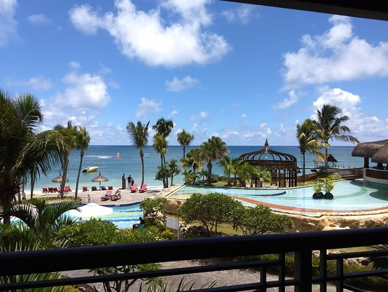 Main pool and beach area, as seen from the lobby bar; the roof on ...