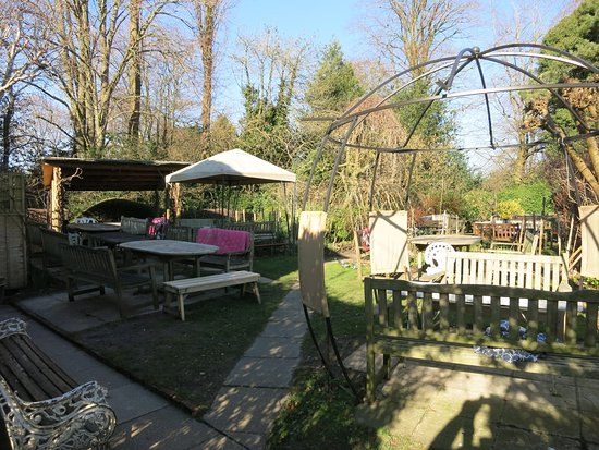 The Harrow: Garden with cushions on the benches and blankes to keep warm!