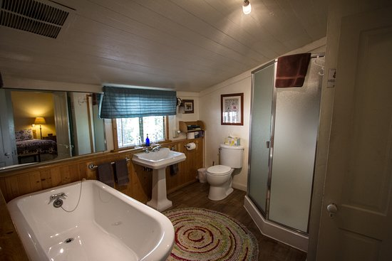 Outside Inn: The Cottage bathroom, complete with tub and shower
