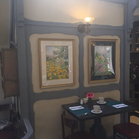 The Tuck Box: Walls adorned with art and traditional porcelain teapots.