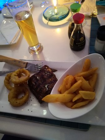 Catch 22 Beachside Grille & Bar: Steak - which apparently was delicious with onion rings and chips