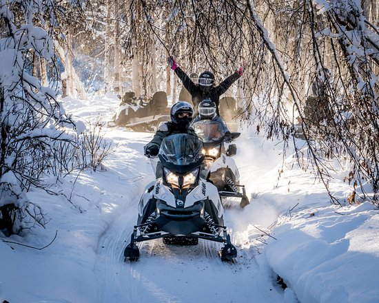 Fairbanks, AK: Enjoying the warm sunshine on a snowmobile ride