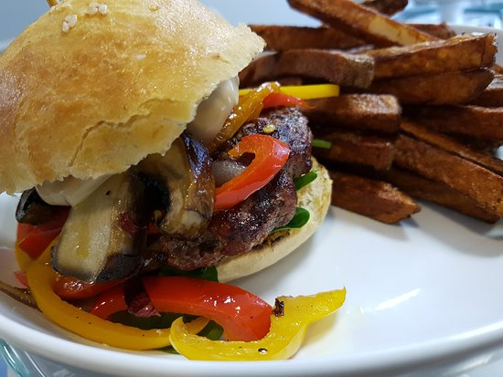 Smiths Falls, كندا: One of our Specials, The Saute Burger, tri colour peppers, portobello mushrooms, sesame tamari m