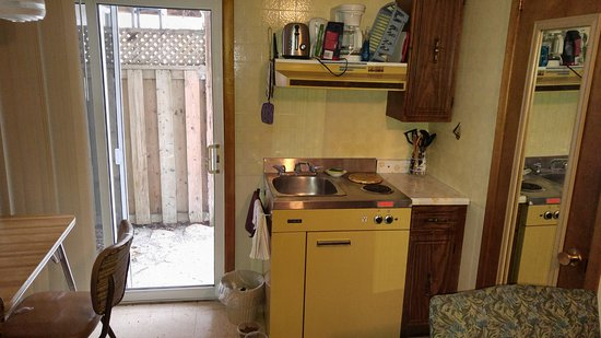 The kitchenette and back patio door picture of stone fountain stone fountain motel the kitchenette and back patio door planetlyrics Image collections