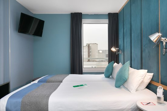 Quality hotel suites bercy bibliotheque by happyculture chambre twin