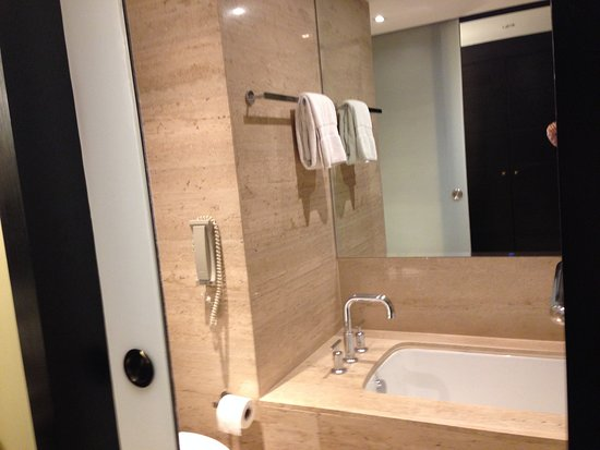 JW Marriott El Convento Cusco Sliding door reveals bath shower toilet. & Sliding door reveals bath shower toilet. - Picture of JW Marriott ...