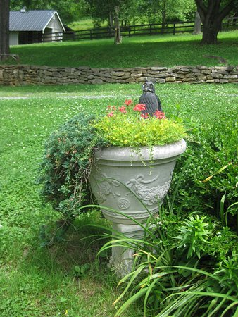 Sperryville, VA: One of a pair of urns at the entrance by the parking area.