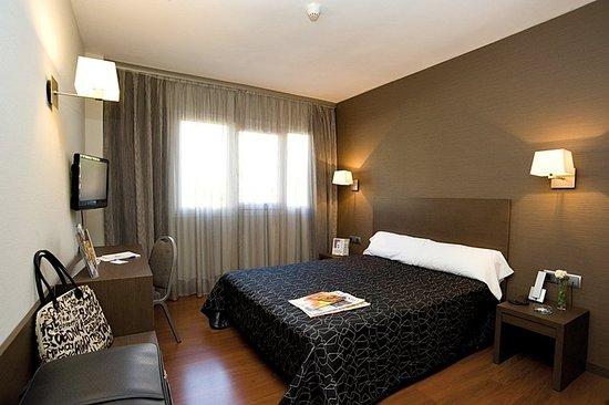 Hotel Cisneros: Guest room