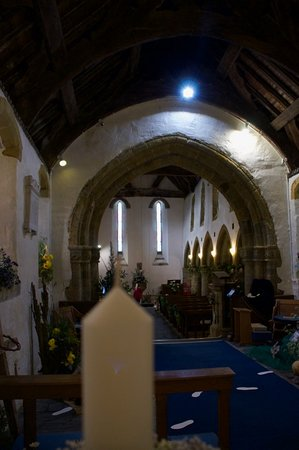 Llanaber, UK: St Mary's Church interior looking rearwards during flower festival