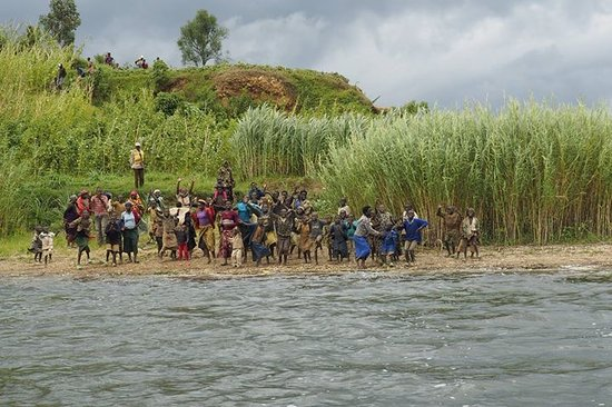 Northern Province, Rwanda: Villagers cheering for our arrival