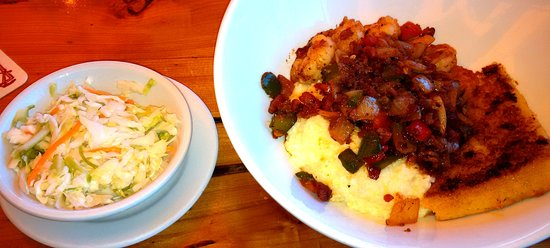Jensen Beach, FL: Shrimp & grits with bacon bits and cole slaw.