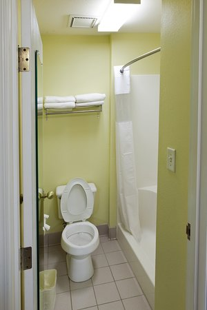Clean Bathroom with Curved Shower Rods - Picture of Country Hearth ...