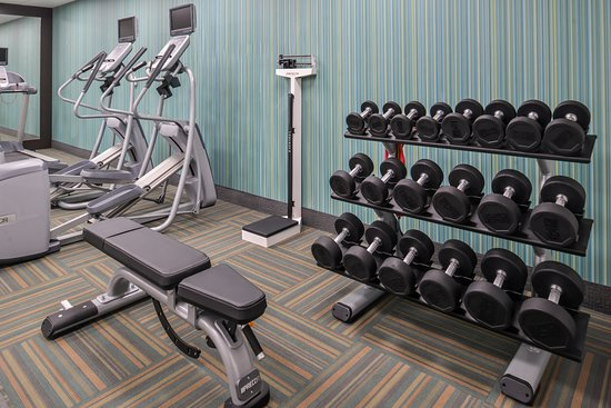 Fitness room with free weights picture of holiday inn