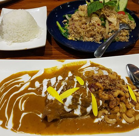 Concord, Australia: Chilli Basil chicken fried and Lamb shank in Massaman curry